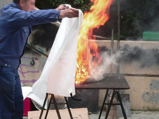 Man Using A Fire Blanket